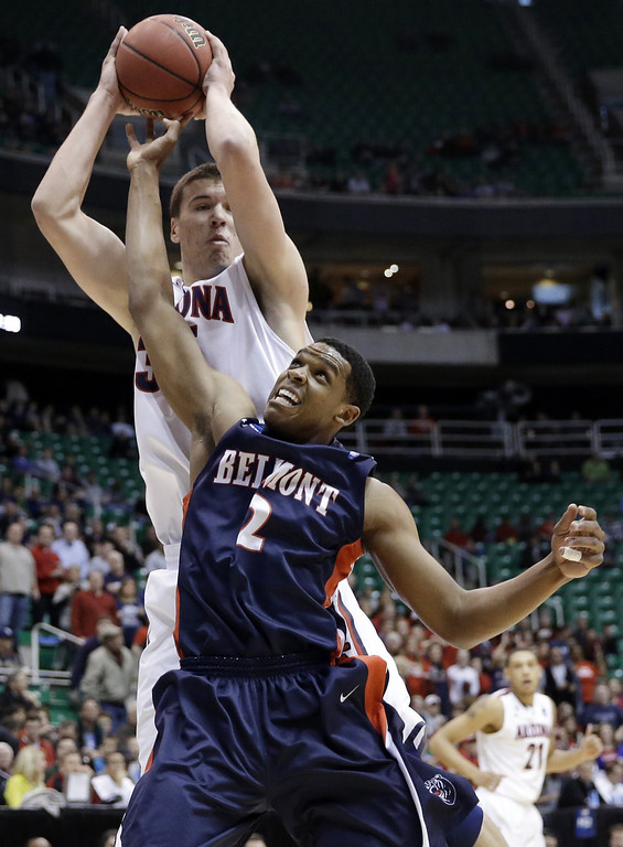 . Arizona\'s Kaleb Tarczewski, rear, pulls down a rebound over Belmont\'s Blake Jenkins (2) during the first half in a second-round game in the NCAA college basketball tournament in Salt Lake City Thursday, March 21, 2013. (AP Photo/Rick Bowmer)