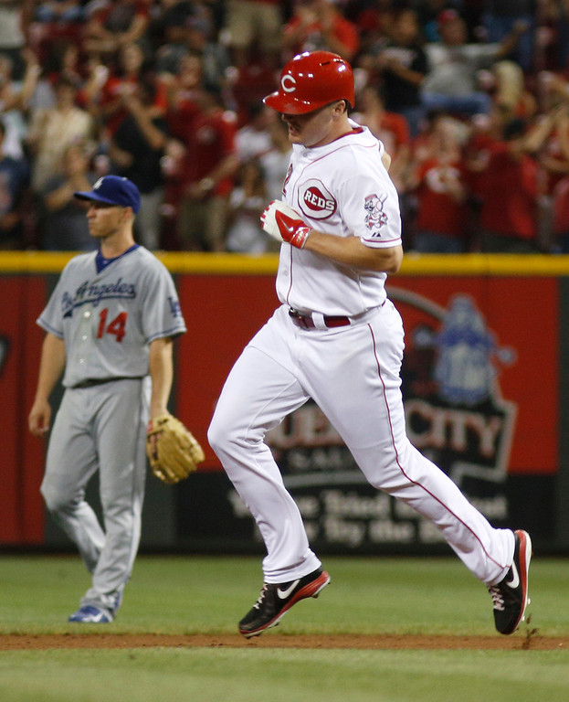 . Cincinnati Reds\' Jay Bruce, right, rounds the bases after hitting a solo home run off Los Angeles Dodgers pitcher Clayton Kershaw in the fourth inning of a baseball game, Sunday, Sept. 8, 2013, in Cincinnati. Dodgers second baseman Mark Ellis is at left. (AP Photo/David Kohl)