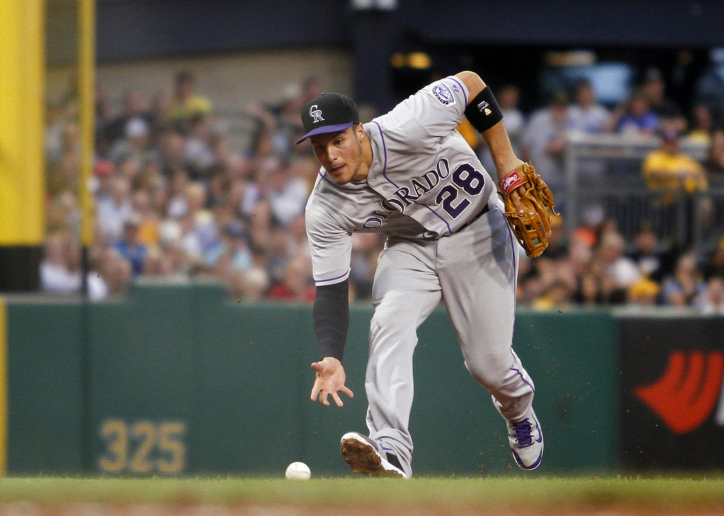 . PITTSBURGH, PA - JULY 18:  Nolan Arenado #28 of the Colorado Rockies fields a ground ball in the third inning against the Pittsburgh Pirates during the game at PNC Park July 18, 2014 in Pittsburgh, Pennsylvania.  (Photo by Justin K. Aller/Getty Images)