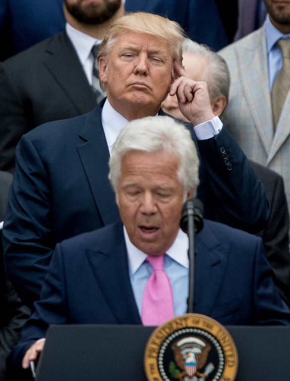. President Donald Trump listens as New England Patriots owner Robert Kraft speaks during a ceremony on the South Lawn of the White House in Washington, Wednesday, April 19, 2017, where the president honored the Super Bowl Champion New England Patriots for their Super Bowl LI victory. (AP Photo/Andrew Harnik)