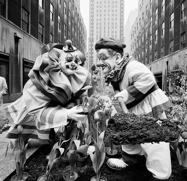 . Clowns from the Ringling Brothers Barnum & Bailey Circus, Blinko, left, and Frankie Saluto, right, lend a hand in planting tulips and other flowers in the Channel Gardens of Rockefeller Center in New York, April 7, 1960. The Spring Bulb Show is the first floral displays to be placed in the gardens that are just off Fifth Avenue. (AP Photo/Hans Von Nolde)
