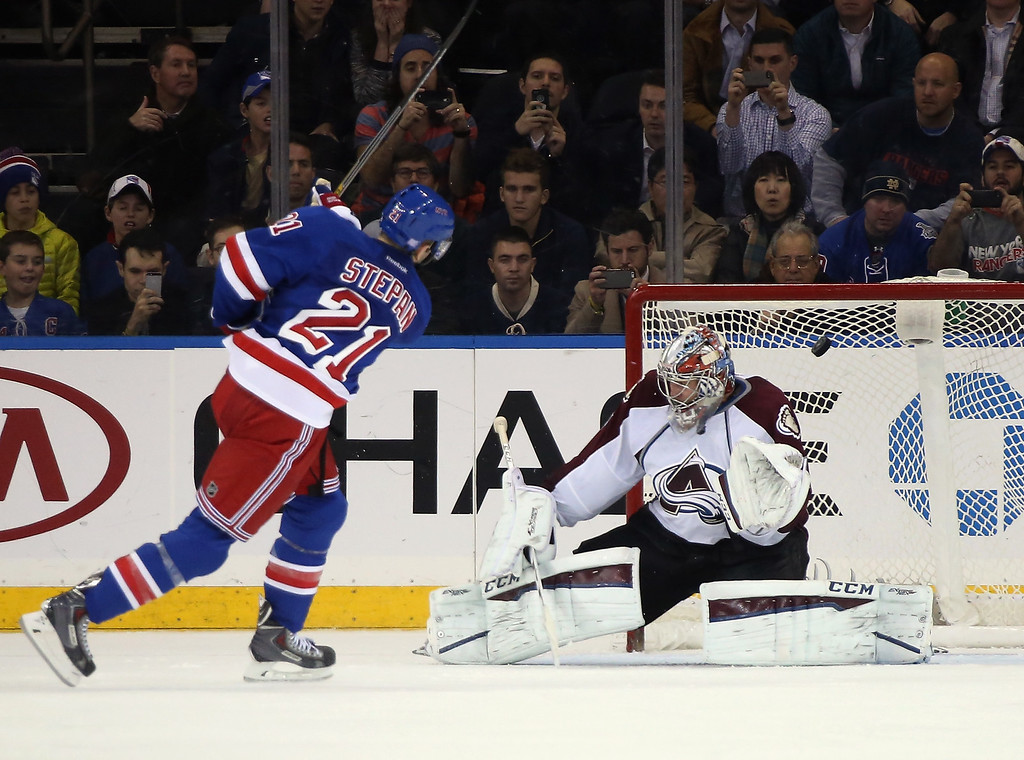 . NEW YORK, NY - NOVEMBER 13: Derek Stepan #21 of the New York Rangers scores a shootout goal past Semyon Varlamov #1 of the Colorado Avalanche at Madison Square Garden on November 13, 2014 in New York City. The Avalanche defeated the Rangers 4-3 in the shootout. (Photo by Bruce Bennett/Getty Images)