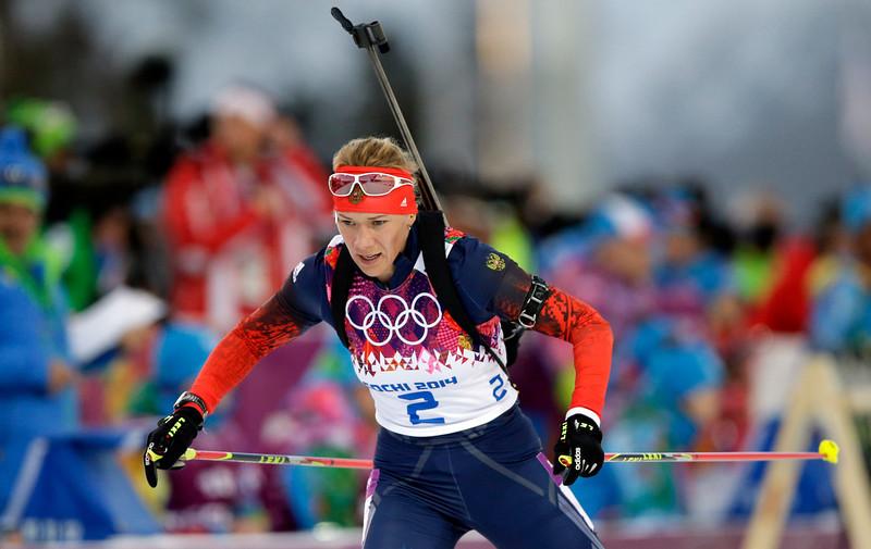 . Russia\'s Olga Zaitseva competes during the women\'s biathlon 15k individual race, at the 2014 Winter Olympics, Friday, Feb. 14, 2014, in Krasnaya Polyana, Russia. (AP Photo/Lee Jin-man)