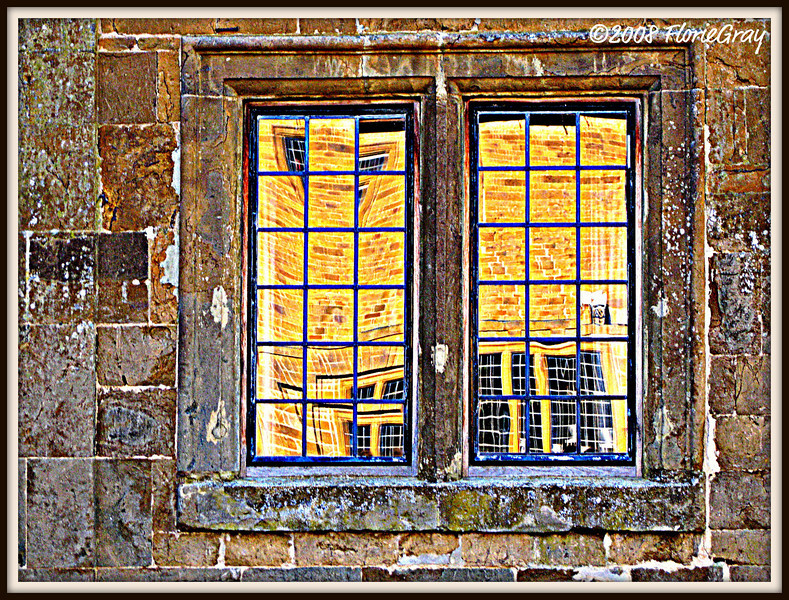Squared  The Buttery, reflected in the windows of Wroxton Abbey