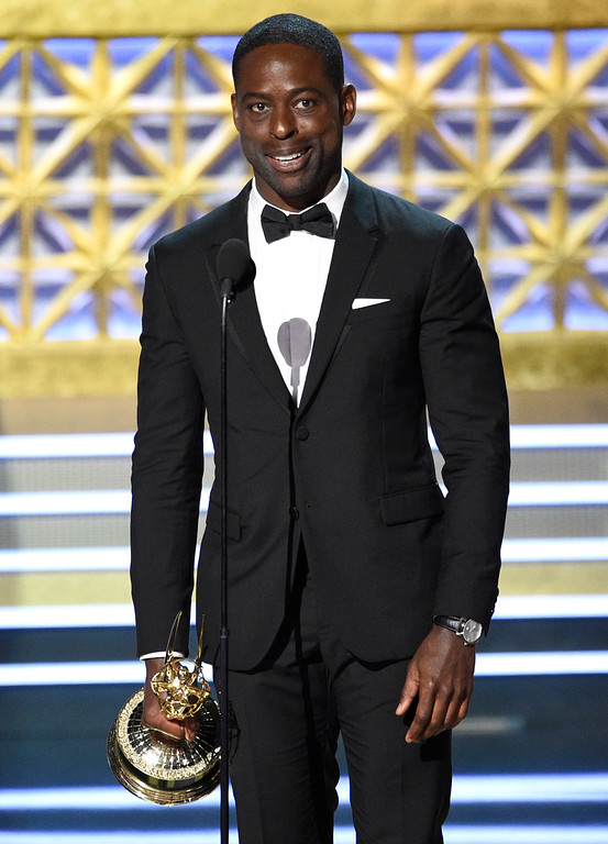 ". Sterling K. Brown accepts the award for outstanding lead actor in a drama series for ""This Is Us\"" at the 69th Primetime Emmy Awards on Sunday, Sept. 17, 2017, at the Microsoft Theater in Los Angeles. (Photo by Chris Pizzello/Invision/AP)"