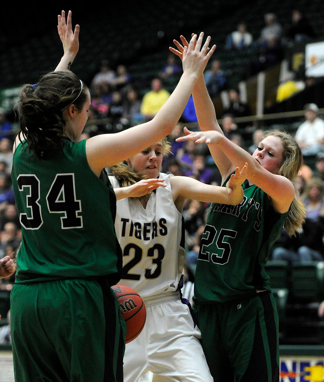 . FT. COLLINS, CO. - MARCH 16TH: Megan McGillin, center, Holy Family, loses the ball against Sarah Burns, left, and St. Mary\'s teammate, Nicole Niles, in the first half of play during the 3A Colorado High School Basketball Championship game at Moby Arena in Ft. Collins Saturday evening, March 16th, 2013. (Photo By Andy Cross/The Denver Post)