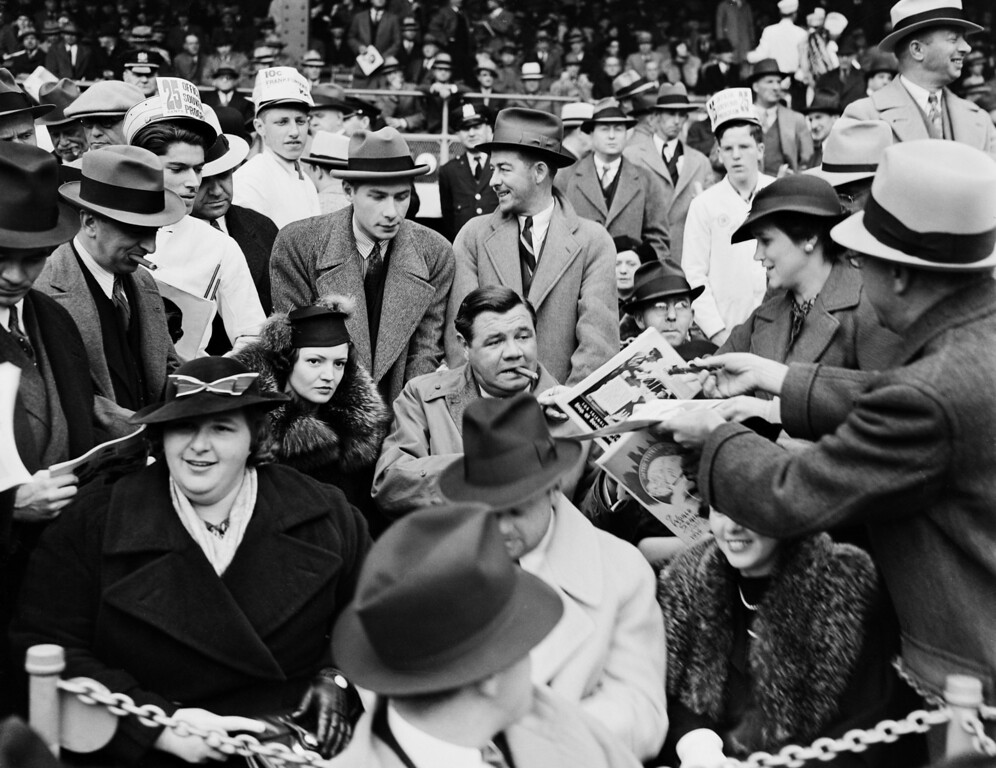 . In this September 30, 1936, Works Progress Administration, Federal Writer\'s Project, photo provided by the New York City Municipal Archives, a man hands a program to baseball legend Babe Ruth, center, as he is joined by his second wife Clare, center left, and singer Kate Smith, front left, in the grandstand during Game 1 of the 1936 World Series at the Polo Grounds in New York. Over 870,000 photos from an archive that exceeds 2.2 million images have been scanned and made available online, for the first time giving a global audience a view of a rich collection that documents New York City life.  (AP Photo/New York City Municipal Archives, WPA Federal Writers\' Project)