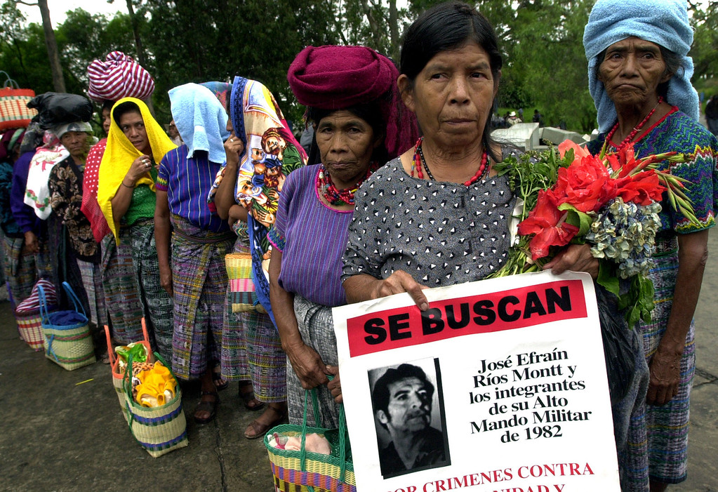 . Mayan Indian widow Gregoria Luisa de la Cruz holds an anti-former dictator Efrain Rios Montt sign, during a march in Guatemala City Wednesday, July 16, 2003. Her husband, Urgencio de Paz, was killed in 1982, during Rios Montt\'s regime. Protesters, mostly from the Mayan indigenous community, marched Wednesday to attend the creation of the National Commission for the assistance of victims of the country\'s civil war. The formation of the commission was part of peace accords which were signed in 1996 between leftist guerrillas and the State of Guatemala. Protesters were also marching against the country\'s highest court clearing the way for Rios Montt to run for president in the country\'s november 2003 elections. (AP photo/ Rodrigo Abd)