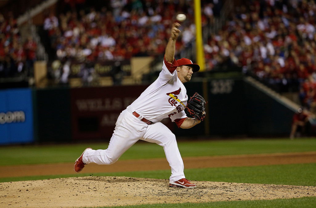 . St. Louis Cardinals relief pitcher Trevor Rosenthal throws during the ninth inning of Game 1 of the National League baseball championship series against the Los Angeles Dodgers, Friday, Oct. 11, 2013, in St. Louis. (AP Photo/David J. Phillip)
