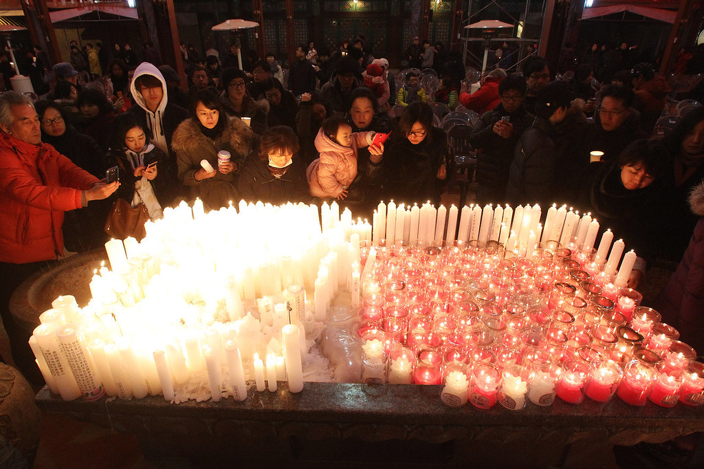 . Buddhists light candles during New Year\'s Eve celebrations at Bongeun Buddhist temple in Seoul, South Korea, Wednesday, Jan. 1, 2014. (AP Photo/Ahn Young-joon)