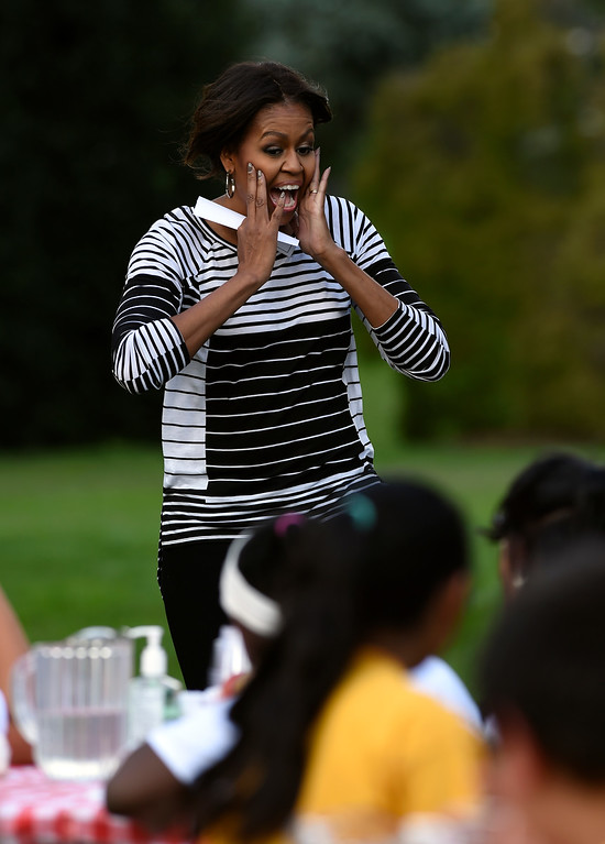 . First lady Michelle Obama arrives to help with the harvest of the White House Kitchen Garden with school children at the White House in Washington, Tuesday, Oct. 14, 2014. (AP Photo/Susan Walsh)