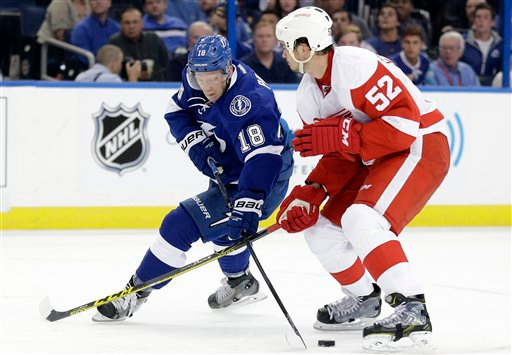 . Tampa Bay Lightning left wing Ondrej Palat (18), of the Czech Republic, gets around Detroit Red Wings defenseman Jonathan Ericsson (52), of Sweden, during the second period of Game 1 of an NHL Eastern Conference playoff hockey series Thursday, April 16, 2015, in Tampa, Fla. (AP Photo/Chris O\'Meara)