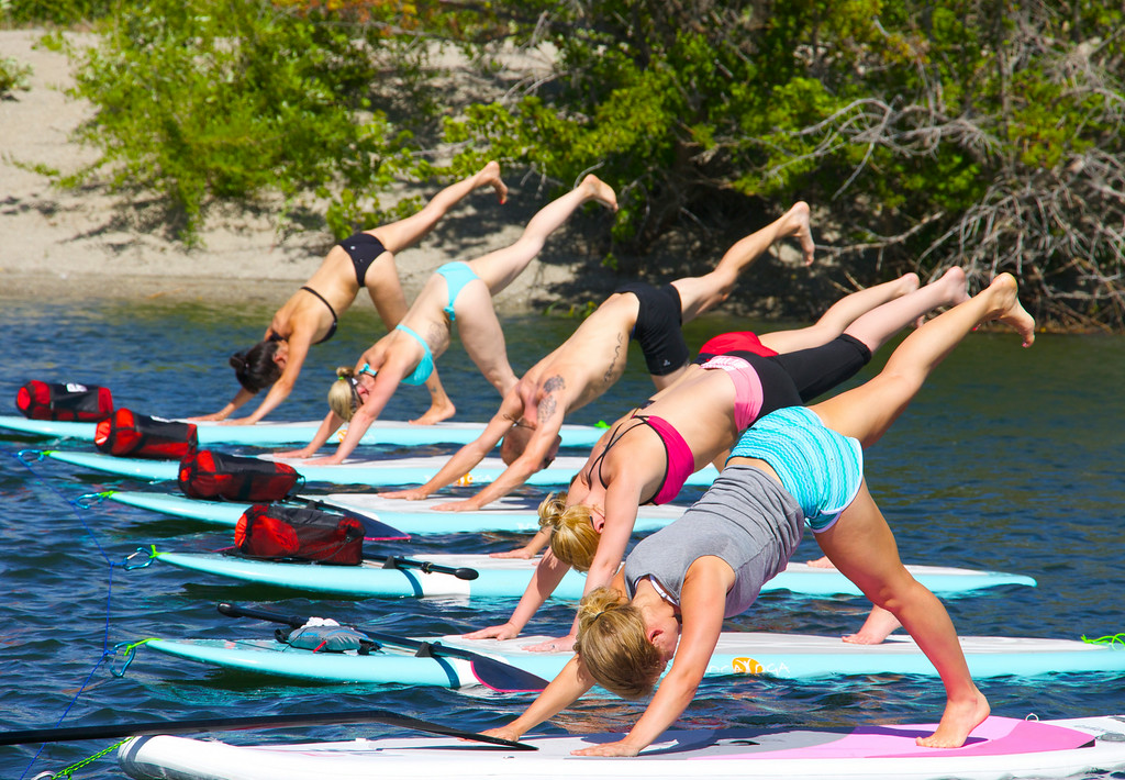 . Students in yoga pose during an iLaYoga stand-up paddle board class on the Columbia River in Wenatchee.  (Photo provided by iLaYoga.com)