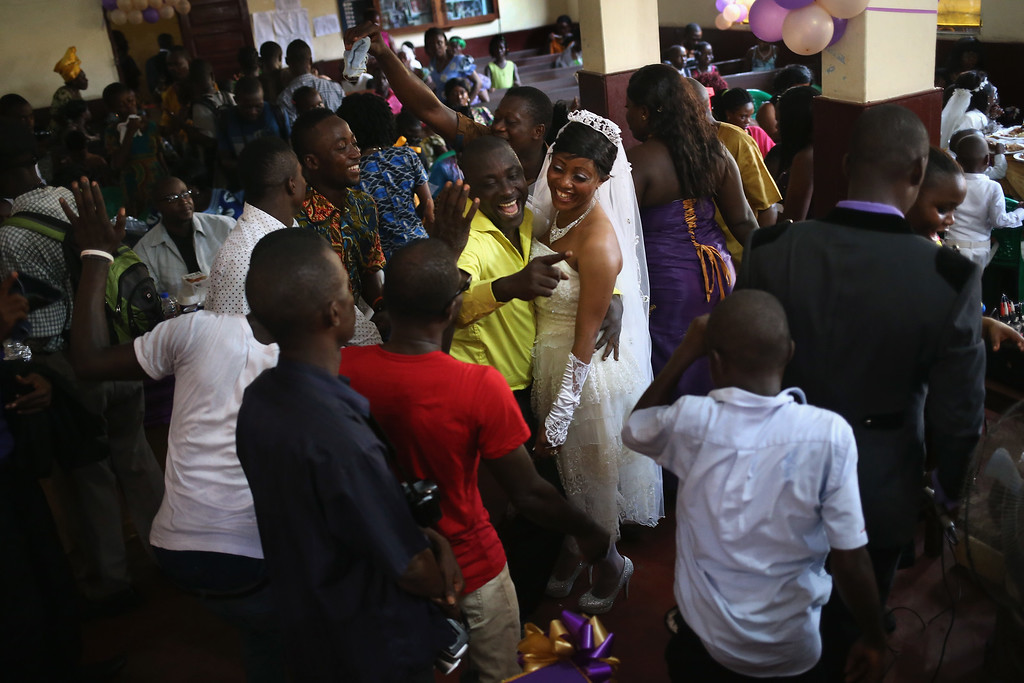 . Bindu Quaye celebrates with friends at her wedding reception on January 24, 2015 in Monrovia, Liberia. Like many couples, Quaye and her groom Clarence Murvee waited until the worst of the Ebola epidemic had passed before scheduling their wedding. In order to control the outbreak, the government and international aid agencies discouraged public gatherings and physical touching. With Ebola cases now in single digits nationwide, people have begun to return to normal life.  (Photo by John Moore/Getty Images)
