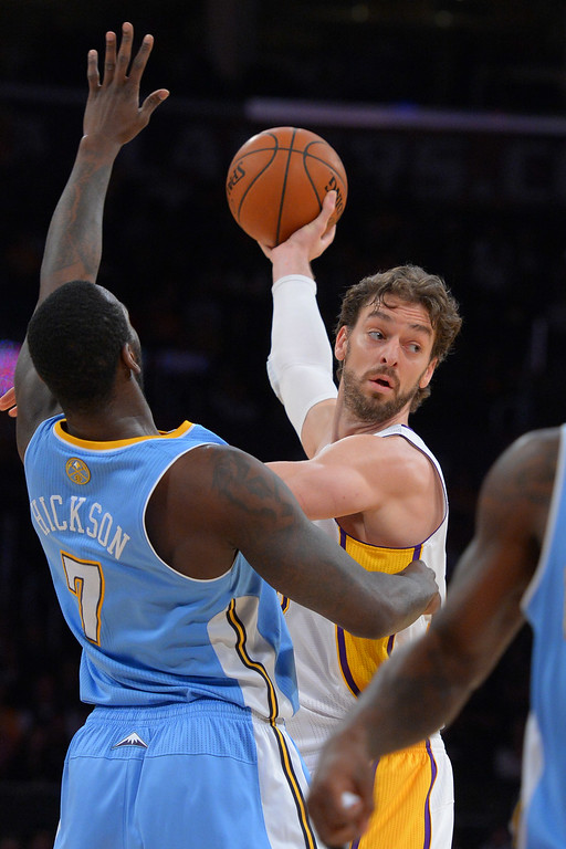 . Lakers Pao Gasol looks for a player to pass to as he\'s defended by the Nuggets\' J.J. Hickson at the Staple Center in Los Angeles, CA on Sunday, January 5, 2014. 1st half.  (Photo by Scott Varley, Daily Breeze)
