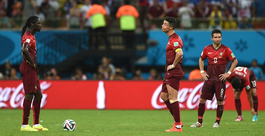 . Portugal\'s Cristiano Ronaldo, second from left, and Portugal\'s Eder, left, react after United States\' Clint Dempsey scored his side\'s second goal during the group G World Cup soccer match between the USA and Portugal at the Arena da Amazonia in Manaus, Brazil, Sunday, June 22, 2014. (AP Photo/Paulo Duarte)