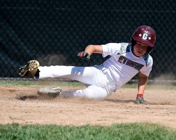 8/9/2018 Mike Orazzi | Staff Goffstown Junior Baseball Little League's Isaac Morin (33) scores Thursday at Breen Field in Bristol.
