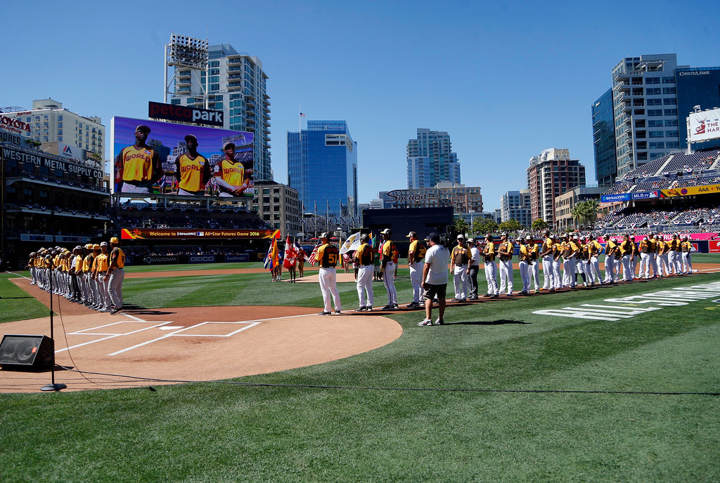 . The U.S. Team and the World Team line up during the National Anthem prior to the All-Star Futures baseball game, Sunday, July 10, 2016, in San Diego. (AP Photo/Lenny Ignelzi)