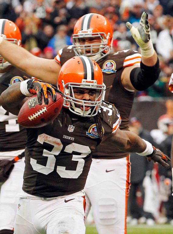 . Cleveland Browns running back Trent Richardson (33) celebrates after a 1-yard touchdown run against the Kansas City Chiefs in the third quarter of an NFL football game Sunday, Dec. 9, 2012, in Cleveland. (AP Photo/Tony Dejak)