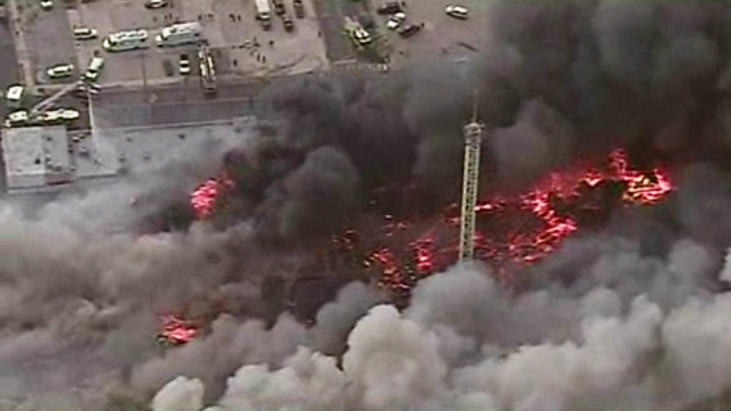 . This image from aerial video shows a raging fire in Seaside Park, N.J. on Thursday, Sept. 12, 2013. The fire began in a frozen custard stand on the Seaside Park section of the boardwalk and quickly spread north into neighboring Seaside Heights. (AP Photo/ABC)