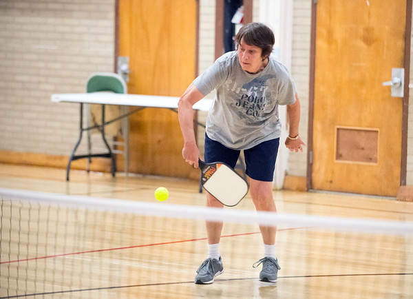 01/06/19 Wesley Bunnell | StaffrrJanet Thibodeau with a backhand return during a doubles game of pickle ball on Monday afternoon at the Bristol Senior Center.