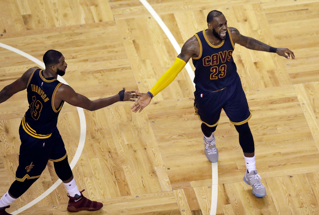 . Cleveland Cavaliers center Tristan Thompson, celebrates with forward LeBron James after a basket during the second quarter of Game 1 of the NBA basketball Eastern Conference finals against the Boston Cetlics, Wednesday, May 17, 2017, in Boston. (AP Photo/Charles Krupa)