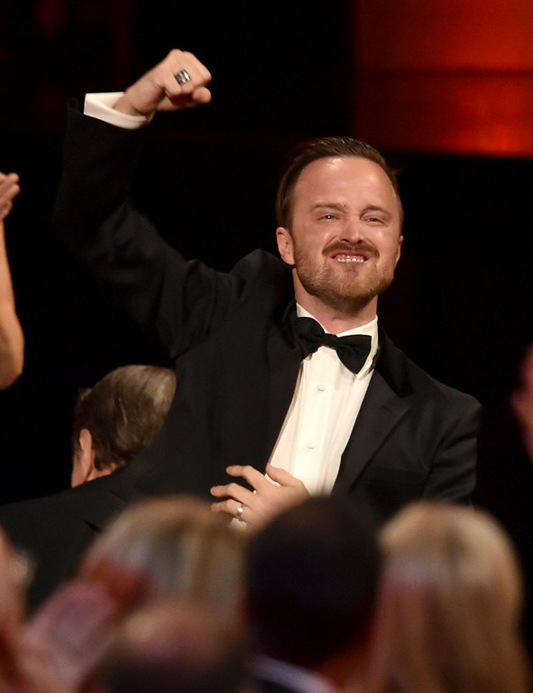 . Actor Aaron Paul celebrates co-star Bryan Cranston winning Outstanding Lead Actor in a Drama Series for \'Breaking Bad\' onstage at the 66th Annual Primetime Emmy Awards held at Nokia Theatre L.A. Live on August 25, 2014 in Los Angeles, California.  (Photo by Kevin Winter/Getty Images)