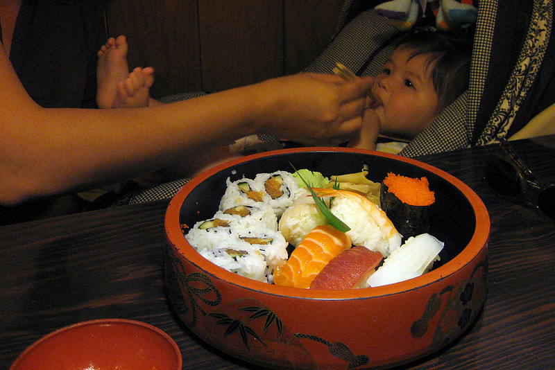 Julia's first sushi experience at Misai Restaurant (198 days old)
