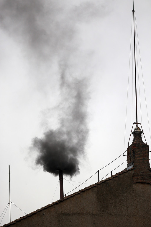 . Black smoke billows out from a chimney on the roof of the Sistine Chapel indicating that the College of Cardinals have failed to elect a new Pope on March 13, 2013 in Vatican City, Vatican.  Pope Benedict XVI\'s successor is being chosen by the College of Cardinals in Conclave in the Sistine Chapel. The 115 cardinal-electors, meeting in strict secrecy, will need to reach a two-thirds-plus-one vote majority to elect the 266th Pontiff.  (Photo by Christopher Furlong/Getty Images)