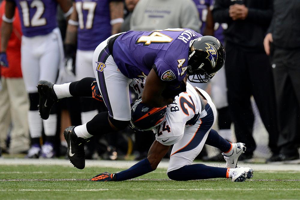 . Denver Broncos cornerback Champ Bailey #24 stops Baltimore Ravens fullback Vonta Leach #44 at the M&T Bank Stadium, in Baltimore , MD Sunday December 16, 2012.      Joe Amon, The Denver Post