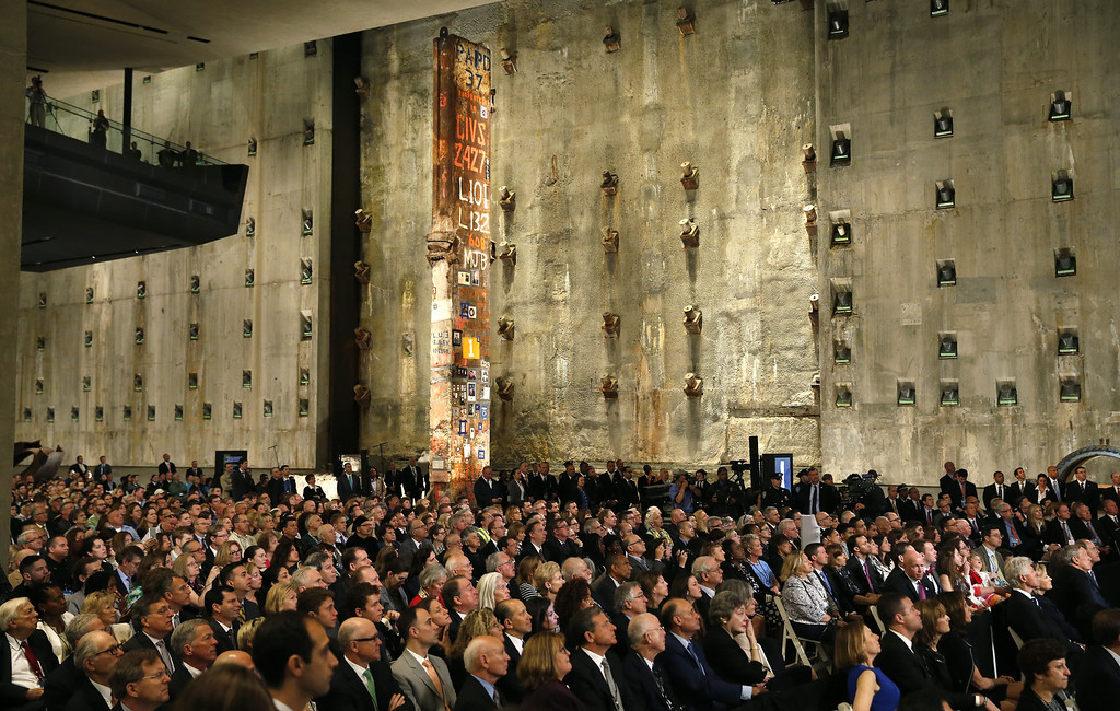 . Invited guests listen as U.S. President Barack Obama speaks during the opening ceremony for the National September 11 Memorial Museum at ground zero May 15, 2014 in New York City.   (Photo by Mike Segar-Pool/Getty Images)