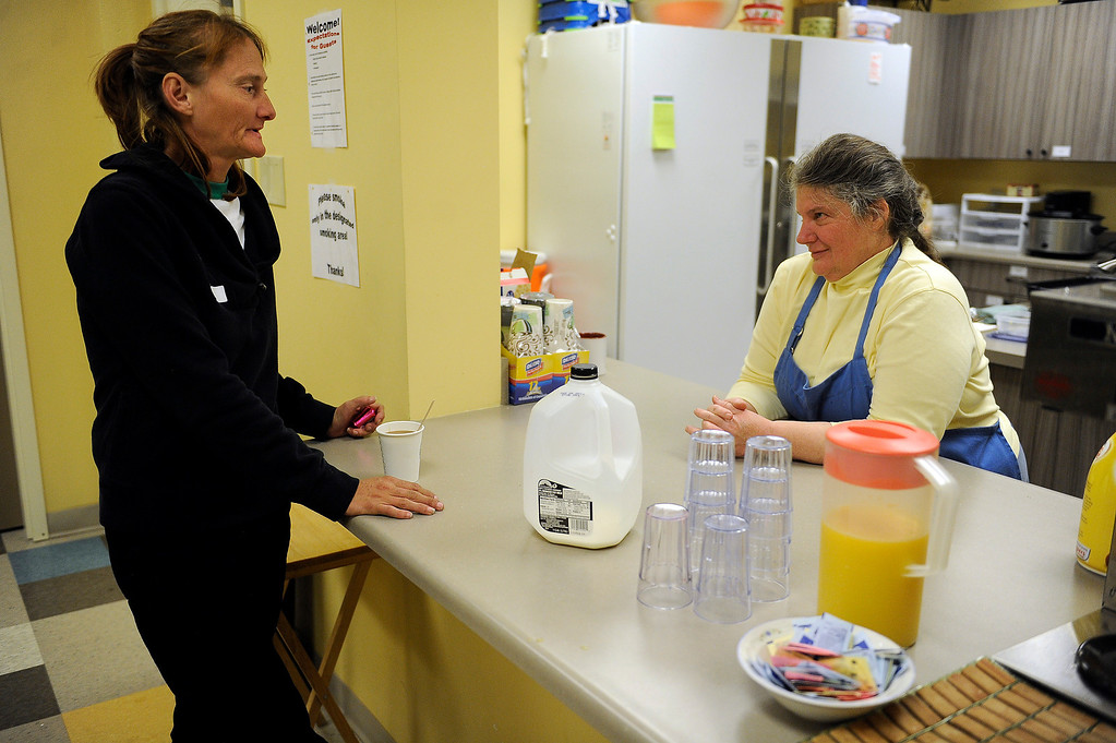 . GOLDEN, CO - JANUARY 22: Sherry White, left, chats with volunteer Monica Granitto during dinner at Applewood Community Church in Golden, Colorado on January 22, 2014. The Jefferson County Action Center began partnering with churches last year to offer emergency shelter for the homeless on severe weather nights. (Photo by Seth McConnell/The Denver Post)