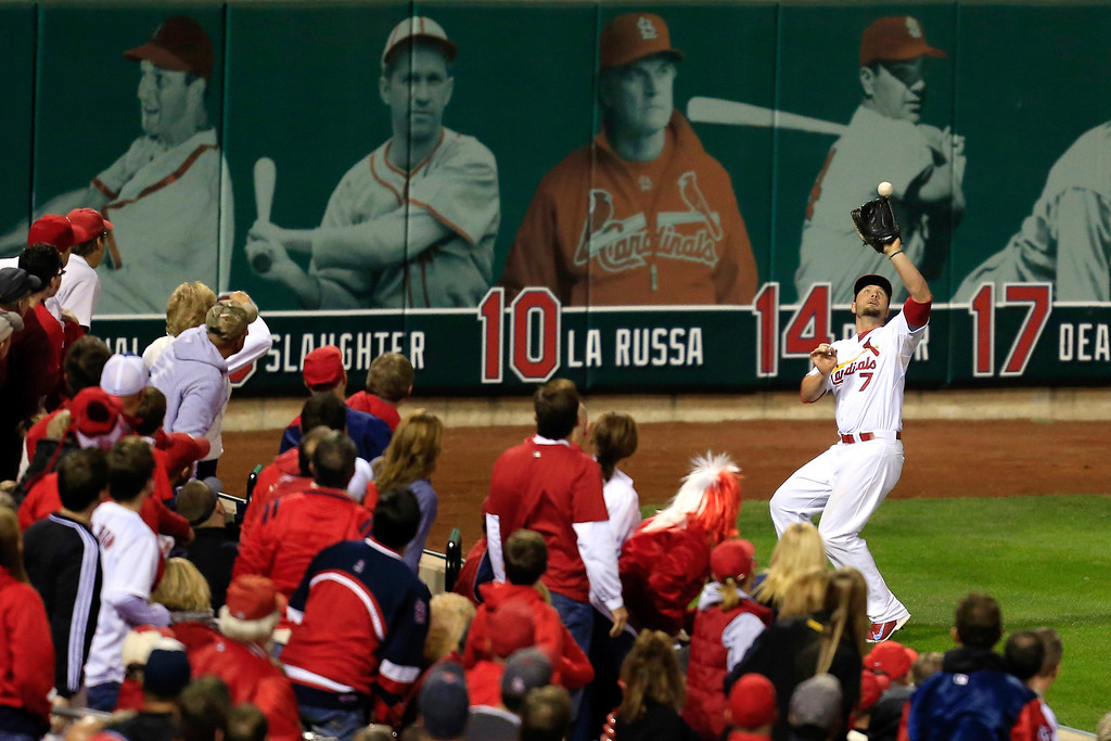 . Matt Holliday #7 of the St. Louis Cardinals fields a ball hit by Jonny Gomes #5 of the Boston Red Sox for an out in the fourth inning of Game Five of the 2013 World Series at Busch Stadium on October 28, 2013 in St Louis, Missouri.  (Photo by Dilip Vishwanat/Getty Images)