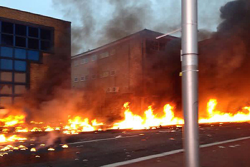 . A collect picture taken by a member of the public shows flames on a road following the crash of a helicopter in central London, on January 16, 2013. Two people were killed when a helicopter hit a crane at a building site in central London and plunged to the ground on Wednesday, police said.   NIC WALKER/AFP/Getty Images