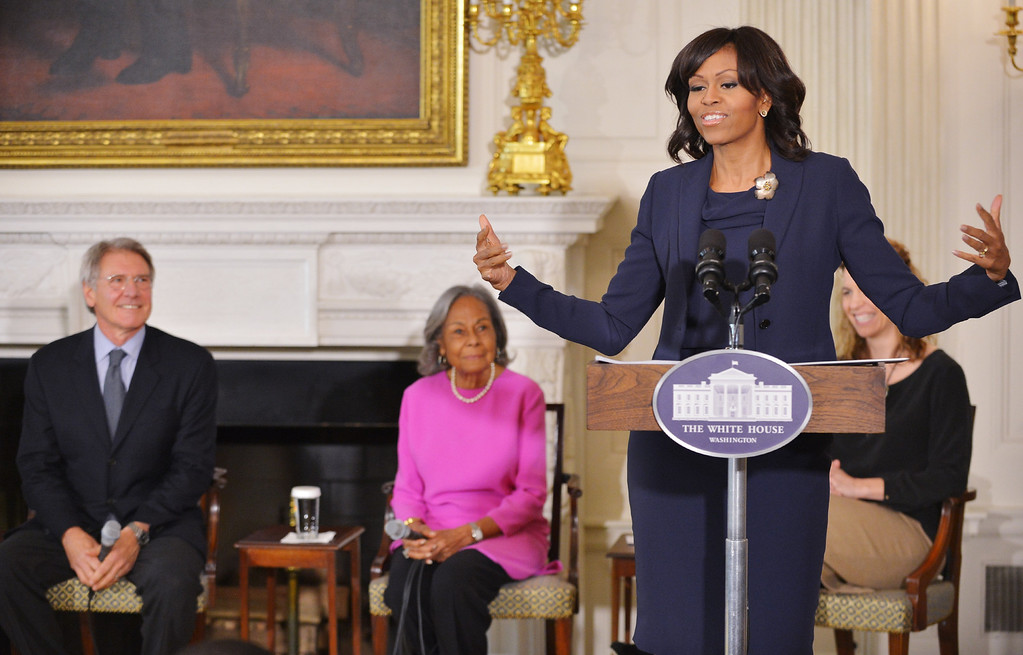 ". First Lady Michelle Obama speaks at the start of a student workshop with the cast and crew of the film ""42\"" on April 2, 2013 in the State Dining Room of the White House in Washington, DC. From left: actor Harrison Ford, who plays Major League Baseball executive Branch Rickey and Rachel Robinson, widow of Jackie Robinson. The movie is the life story of US baseball player Jackie Robinson. (MANDEL NGAN/AFP/Getty Images)"