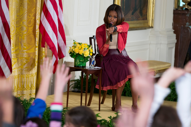 """. First lady Michelle Obama answers questions during the White House\'s annual \""""Take Our Daughters and Sons to Work Day,\"""" Thursday, April 24, 2014, in the East Room of the White House in Washington.  (AP Photo/ Evan Vucci)"""