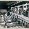 """Title: The Interior. """"Clean Up"""" day at the Deadwood Terra Gold Stamp Mill, one of the Homestake Mills, Terraville, Dakota<br /> Interior of saw mill; men working on equipment. 1888.<br /> Repository: Library of Congress Prints and Photographs Division Washington, D.C. 20540"""