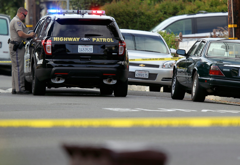 . A California Highway Patrol officer blocks off a portion of Myrtle Street near Lion Street where a Hayward police officer was killed in Hayward, Calif., Wednesday, July 22, 2015. (Anda Chu/Bay Area News Group)