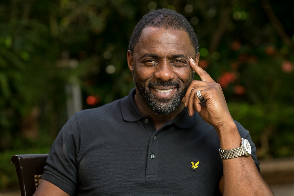 """. In this Sunday, Nov. 10, 2013 photo, actor Idris Elba poses for a portrait at the Four Seasons in Beverly Hills, Calif.  Elba was nominated for an Emmy Award for best actor in a miniseries or movie for his role in \""""Luther,\"""" on Thursday, July 10, 2014. The 66th Primetime Emmy Awards will be presented Aug. 25 at the Nokia Theatre in Los Angeles.. (Photo by Paul A. Hebert/Invision/AP)"""