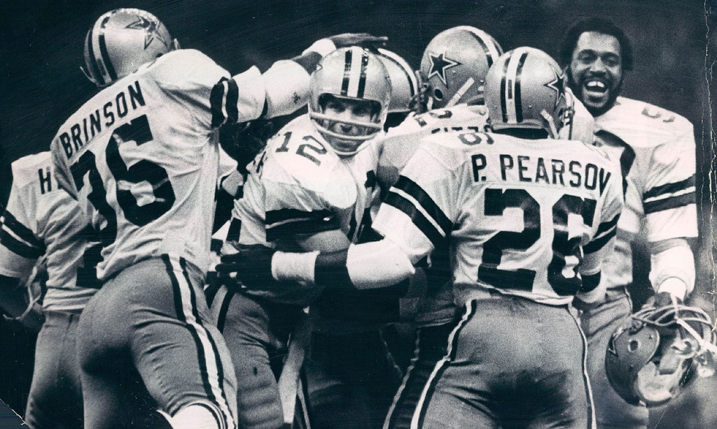 . The Dallas Cowboys swarm quarterback Roger Staubach (12) and a bunch of teammates after they beat the Denver Broncos, 27-10, in Super Bowl XII. (Photo By Kenn Bisio/The Denver Post)