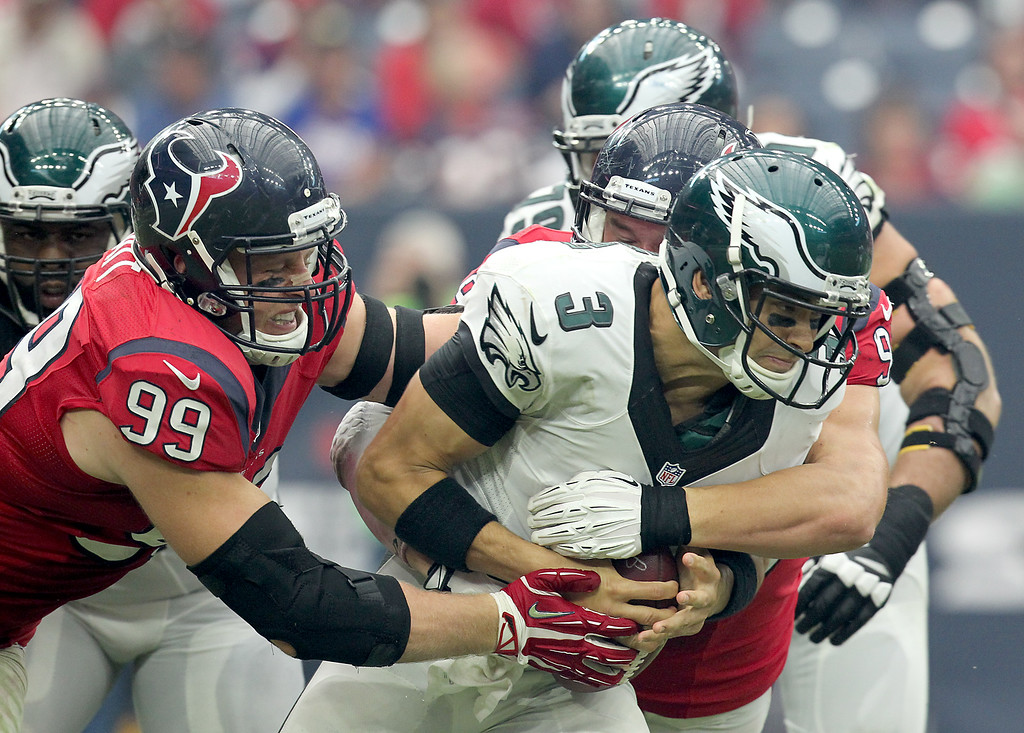 . J.J. Watt #99 of the Houston Texans sacks Mark Sanchez #3 of the Philadelphia Eagles in the second half in a NFL game on November 2, 2014 at NRG Stadium in Houston, Texas. Eagles won 31 to 21. (Photo by Thomas B. Shea/Getty Images)