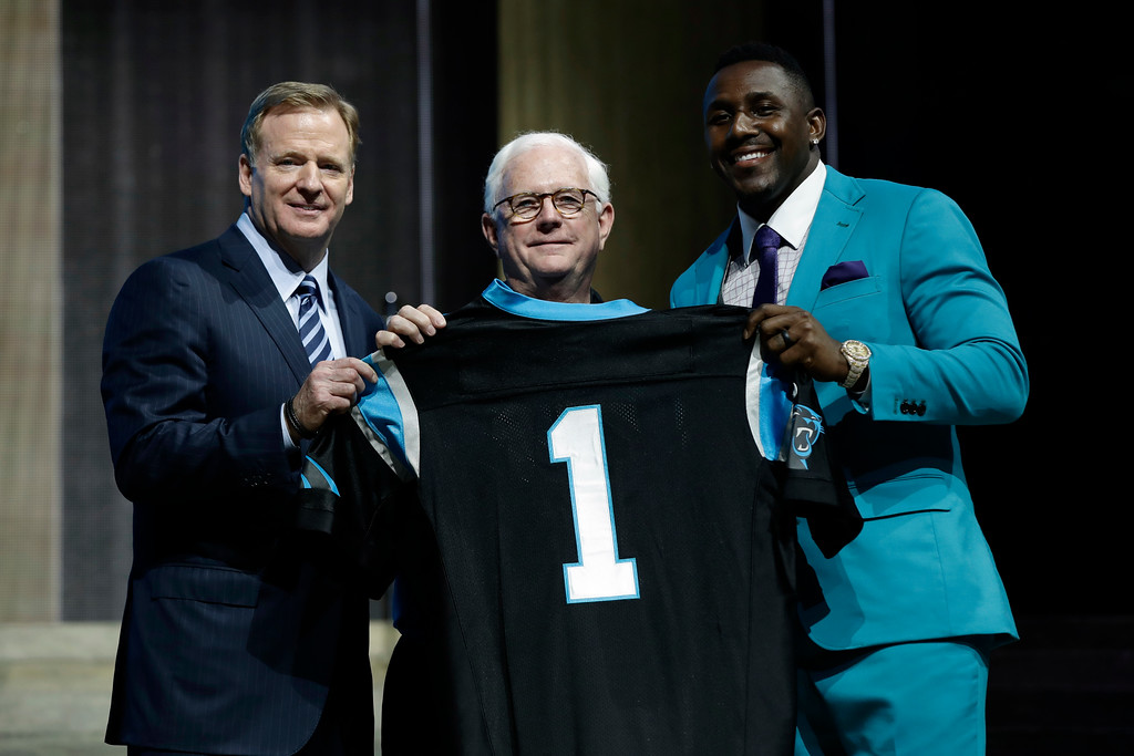. NFL commissioner Roger Goodell, left, and Carolina Panthers\' Thomas Davis, right, pose with a fan after the Panthers selected Stanford\'s Christian McCaffrey during the first round of the 2017 NFL football draft, Thursday, April 27, 2017, in Philadelphia. (AP Photo/Matt Rourke)