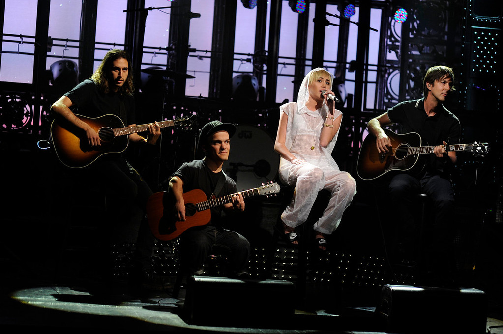 """. Guest host Miley Cyrus performing during the late-night comedy series \""""Saturday Night Live,\"""" in New York on Oct. 5, 2013. (AP Photo/NBC, Dana Edelson)"""
