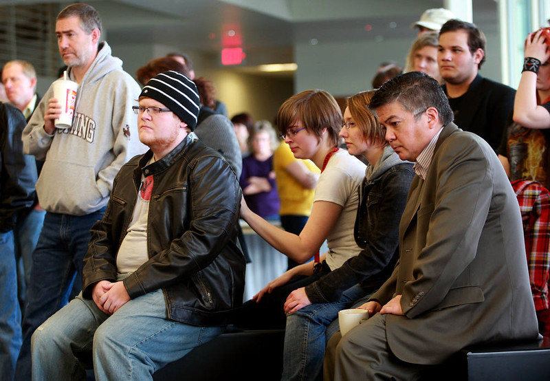 . Students and staff listen to a news conference after an apparent murder-suicide on campus Friday, Nov. 30, 2012 at Casper College in Casper, Wyo. Police say a male suspect killed two people with an edged weapon before killing himself in a classroom at the college where students were present.  Police found two of those killed at a science building on the Casper College campus and the third at another location about 2 miles away. Authorities didn\'t identify the suspect or victims but said two were male and one was female. The suspect wasn\'t believed to be a student, but it appeared there was a relationship between the suspect and victims killed, Police Chief Chris Walsh said.  (AP Photo/The Casper Star-Tribune, Alan Rogers)  TRIB.COM