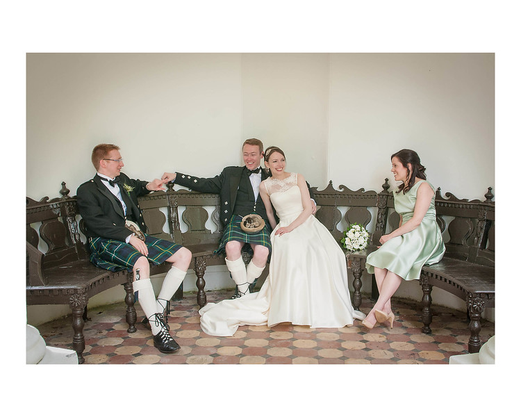 Wedding Photography of Susan & Ross, Barony Castle, Peebles, Scotland, Photograph is of the Bride & Groom & wedding party sitting laughing