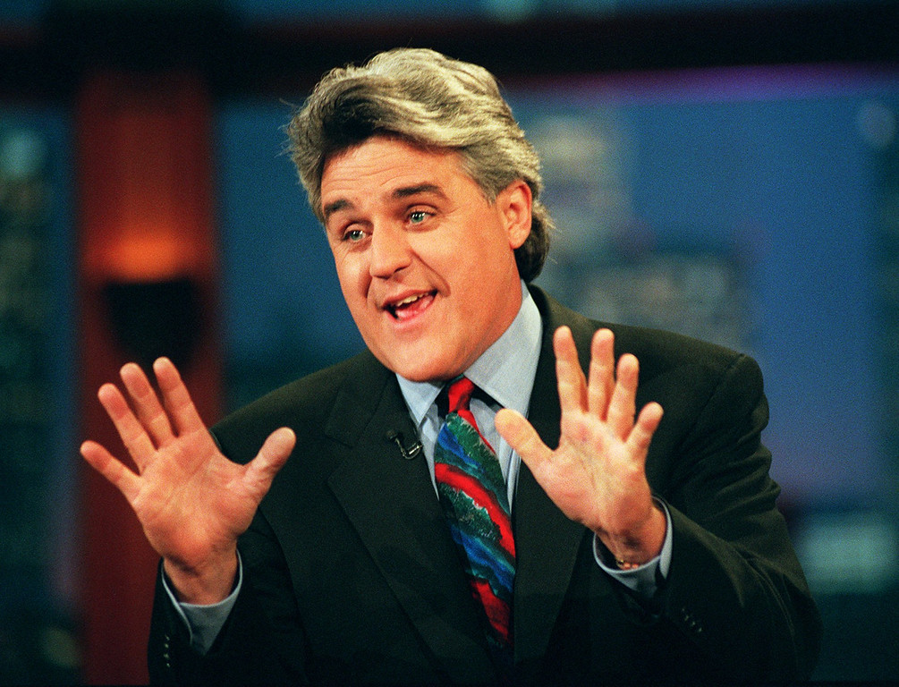 """. Jay Leno performs his monolog Sept. 30, 1996, on \""""The Tonight Show with Jay Leno\"""" in Burbank, Calif. Leno has written a new book, \""""Leading with My Chin,\"""" which he says is not an autobiography. (AP Photo/Mark J. Terrill)"""