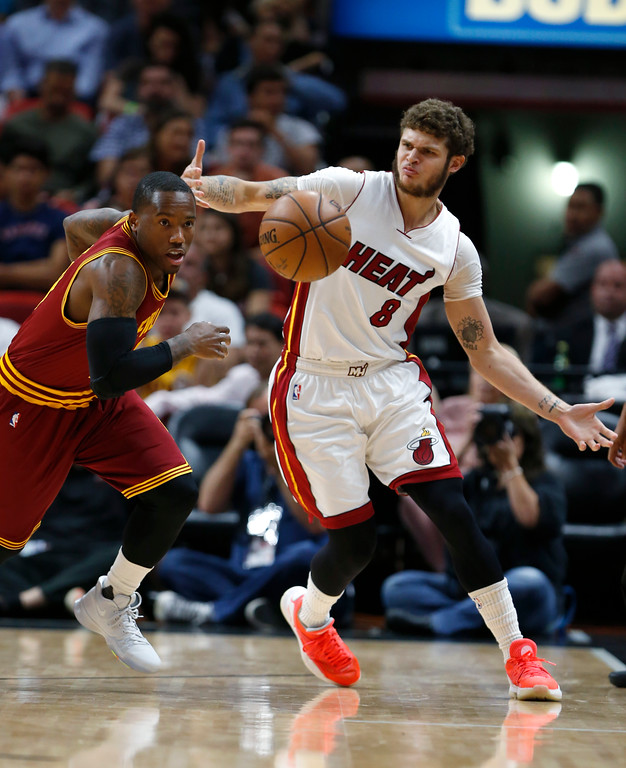 . Cleveland Cavaliers guard Kay Felder, left, steals the ball from Miami Heat guard Tyler Johnson (8) during the first half of an NBA basketball game, Monday, April 10, 2017, in Miami. (AP Photo/Wilfredo Lee)