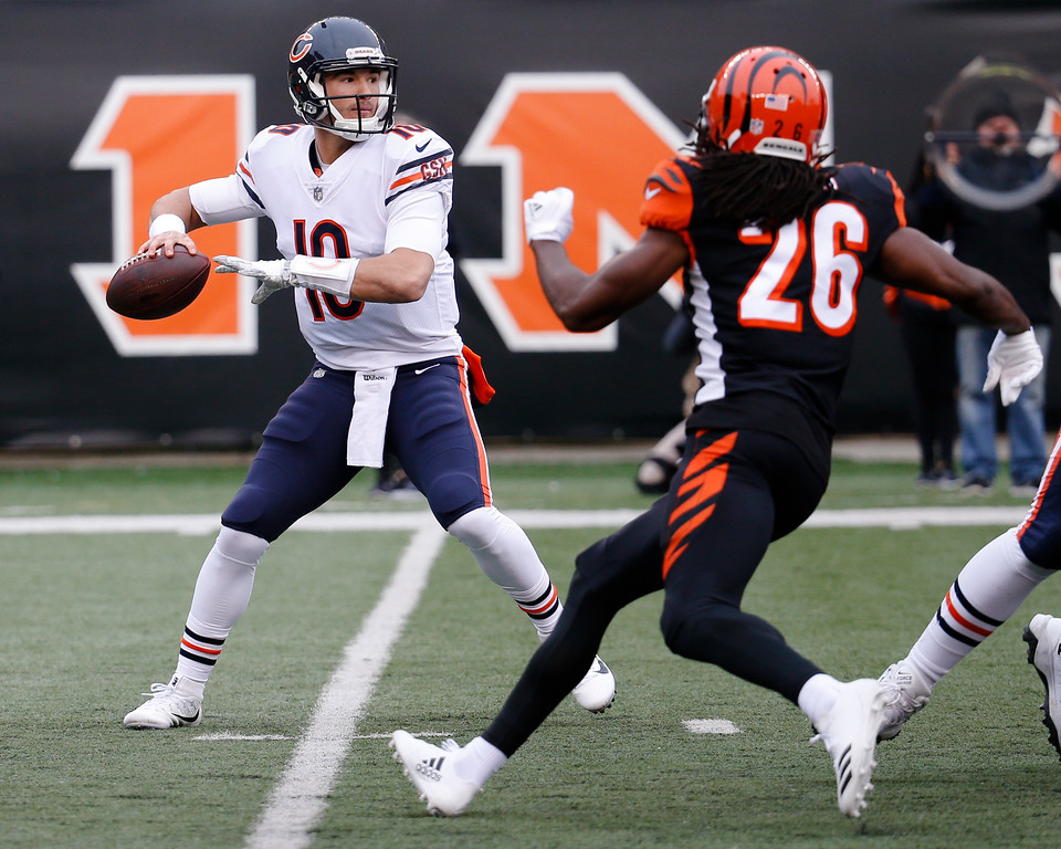 . Chicago Bears quarterback Mitchell Trubisky (10) passes under pressure form Cincinnati Bengals cornerback Josh Shaw (26) in the first half of an NFL football game, Sunday, Dec. 10, 2017, in Cincinnati. (AP Photo/Frank Victores)