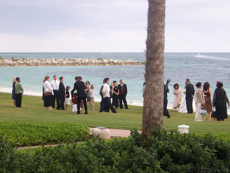 And this is right after that wedding, people mingling on the lawn near the beach.  Awesome setting for a wedding, we think.