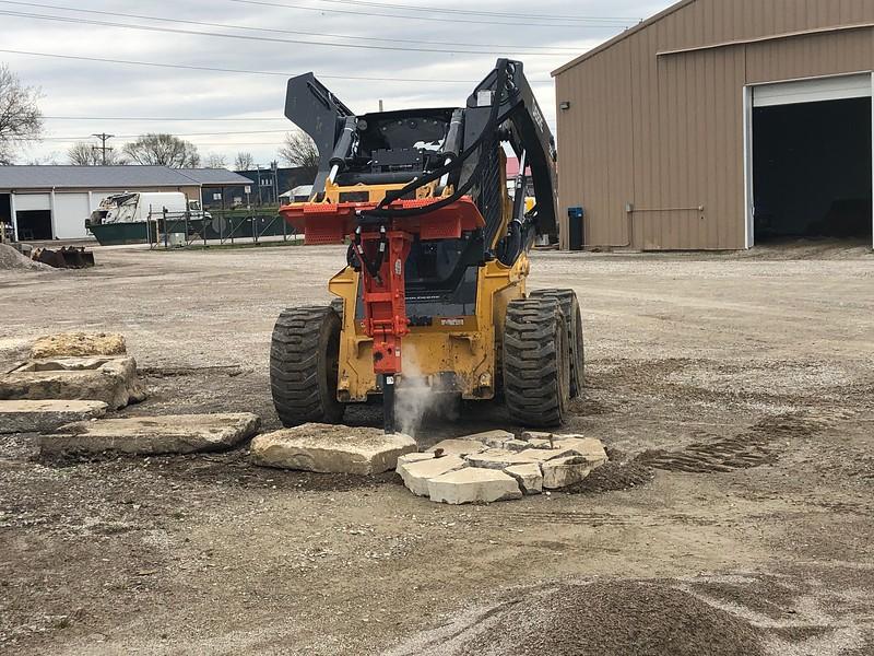 NPK PH2 hydraulic hammer on 332 Deere skid steer - Village of New London, OH  4-20 (1).jpeg